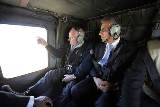 Vice President Dick Cheney and Zalmay Khalilzad, Ambassador to Iraq, depart from Taji Air Base at the 9th Infantry Division Headquarters via helicopter, Sunday Dec. 18, 2005. White House photo by David Bohrer