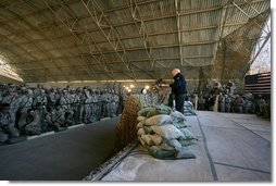 Vice President Dick Cheney attends a rally with US troops at Al-Asad Airbase in Iraq, Dec. 18, 2005.  White House photo by David Bohrer