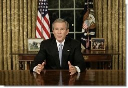 "President George W. Bush addresses the nation Sunday, Dec. 18, 2005, from the Oval Office of the White House. Said the President, ""Next week, Americans will gather to celebrate Christmas and Hanukkah. Many families will be praying for loved ones spending this season far from home in Iraq, Afghanistan or other dangerous places. Our Nation joins in those prayers. We pray for the safety and strength of our troops."" White House photo by Eric Draper"