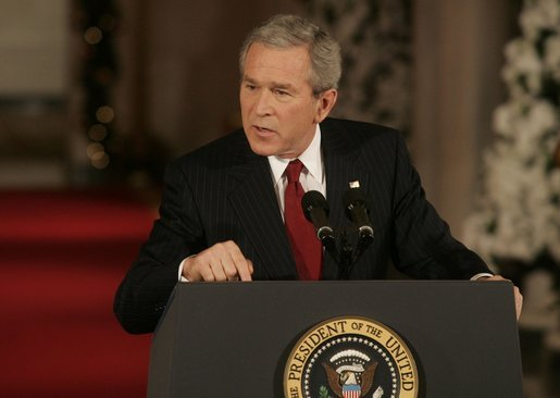 President George W. Bush emphasizes a point as he responds to a reporter's question Monday, Dec. 19, 2005, during a news conference in the East Room of the White House. White House photo by Kimberlee Hewitt