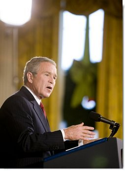 "President George W. Bush addresses the media during a press conference Monday, Dec. 19, 2005, in the East Room of the White House. Before responding to reporters' questioning, the President, speaking on Iraq, told the gathering, "". This election does not mean the end of violence, but it is the beginning of something new: A constitutional democracy at the heart of the Middle East.""  White House photo by Paul Morse"