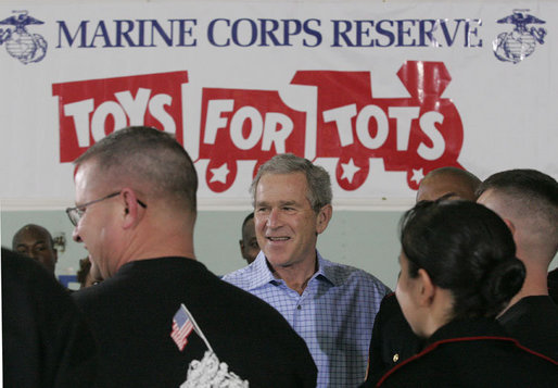 "President George W. Bush meets with U.S. Marines working Monday, Dec. 19, 2005 at the ""Toys for Tots"" collection center at the Naval District Washington Anacostia Annex in Washington, D.C. White House photo by Kimberlee Hewitt"