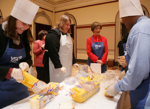 Student participants in the Youth Service Opportunities Project of Washington, D.C.'s Cardozo Senior High School joined Mrs. Laura Bush and her staff, Monday, Dec. 19, 2005, in assembling sandwiches for Martha's Table's mobile soup kitchen. White House photo by Shealah Craighead