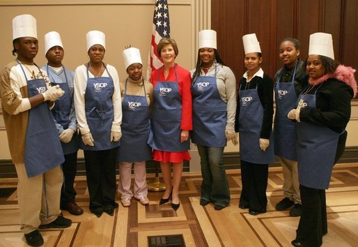 Mrs. Laura Bush and students at Cardozo Senior High School pose for pictures Monday, Dec. 19, 2005, in Washington, D.C. Mrs. Bush was on hand to join the Youth Services Opportunities Project in assembling sandwiches for Martha's Table's mobile soup kitchen. White House photo by Shealah Craighead