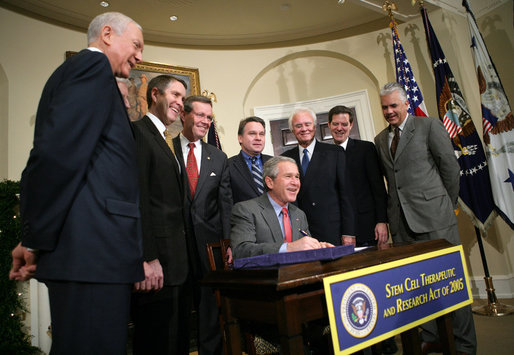 President George W. Bush smiles as he signs into law H.R. 2520, the Stem Cell Therapeutic and Research Act of 2005, during ceremonies Tuesday, Dec. 20, 2005, in the Roosevelt Room of the White House. White House photo by Paul Morse