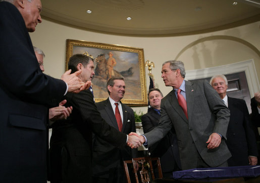 President George W. Bush shakes hands with Senator Bill Frist (R-Tenn.), House Majority Leader, after signing into law H.R. 2520, the Stem Cell Therapeutic and Research Act of 2005, during ceremonies in the Roosevelt Room. White House photo by Paul Morse