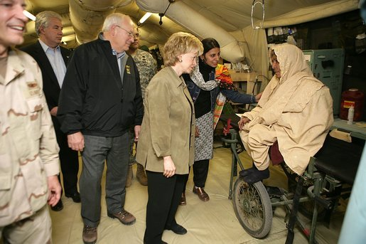 "Vice President Cheney and Mrs. Lynne Cheney visit the 212th M.A.S.H.(Mobile Army Surgical Hospital) Unit run by the U.S. military in a mountainous area near the earthquake's epicenter, 65 miles northwest of Islamabad, Pakistan, Tuesday Dec. 20, 2005. During the visit the Vice President said he was ""impressed with what we've been able to do with our MASH units. U.S. forces were able to move quickly into the area. We were here within 48 hours and we've been here ever since."" White House photo by David Bohrer"