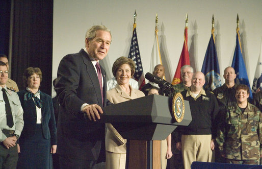 "With Mrs. Laura Bush looking on, President George W. Bush addresses military medical caregivers Wednesday, Dec. 21, 2005, before visiting with the wounded at the National Naval Medical Center in Bethesda, Md. The President told the caregivers, "". On behalf of a grateful nation, thanks for doing your duty, thanks for serving, thanks for being an important part of this march for freedom; and thanks, most of all, for bringing comfort and aid and solace to those who have been hurt on the battlefield and their families."" White House photo by Paul Morse"