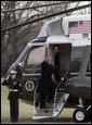 President George W. Bush waves to onlookers as he boards Marine One on the South Lawn Thursday, Dec. 22, 2005, en route to Camp David, where he and family will enjoy the Christmas holiday. White House photo by Kimberlee Hewitt