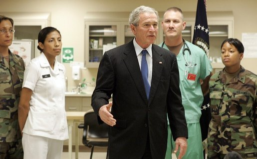 President George W. Bush speaks with the press on Sunday, January 1, 2006, at Brooke Army Medical Center in San Antonio, TX. During his visit to the Medical Center, the President presented nine soldiers with a Purple Heart Award and visited with wounded soldiers and their families. White House photo by Shealah Craighead