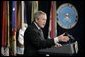 President George W. Bush gestures as he addresses his remarks on the global war on terror, Wednesday, Jan. 4, 2006, to an audience at the Pentagon, following a Department of Defense briefing with Secretary of Defense Donald Rumsfeld and Joint Chiefs of Staff General Peter Pace. White House photo by Eric Draper