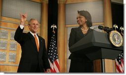 "President George W. Bush returns the ""Hook'em Horns"" hand gesture back to audience members, Thursday, Jan. 5, 2006, as he is being introduced by U.S. Secretary of State Condoleezza Rice at the State Department, prior to his remarks to the U.S. University Presidents Summit on International Education. The gesture was in recognition of the University of Texas football team's victory over the University of Southern California in the Rose Bowl, Wednesday evening.  White House photo by Kimberlee Hewitt"