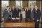Accompanied by Laura Bush and legislators, President George W. Bush signs H.R. 3402, The Violence Against Women and Department of Justice Reauthorization Act of 2005, during a ceremony in the Oval Office Thursday, Jan. 5, 2005. The bill is a comprehensive package that reauthorizes Department of Justice programs to combat domestic violence, dating violence, sexual assault, and stalking. White House photo by Paul Morse