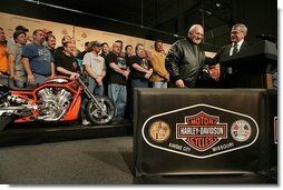 "Vice President Dick Cheney wears a leather jacket given to him by Harley-Davidson CEO Jim Ziemer after touring the motorcycle plant and delivering remarks to the company's employees in Kansas City, Friday January 6, 2006. During his remarks the Vice President said, ""To have the experience of visiting this Harley-Davidson plant is to see, collected under one roof, so much of what is best in the American economy: the hard work, the commitment to quality, and the optimism that drives us forward.""  White House photo by David Bohrer"