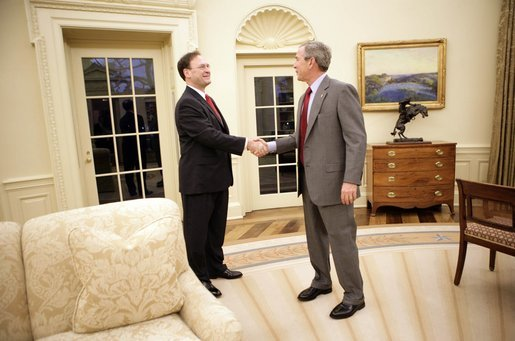 President George W. Bush and Judge Samuel A. Alito shake hands in the Oval Office of the White House Monday, Jan. 9, 2006, before breakfast in the Private Dining Room. Confirmation hearings for Judge Alito, President Bush's nominee for Associate Justice of the Supreme Court, were scheduled to begin today in Washington. White House photo by Eric Draper