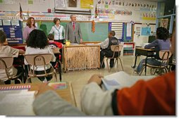 "President George W. Bush and Mrs. Laura Bush visit students at North Glen Elementary School in Glen Burnie, Md., Monday, Jan. 9, 2006. ""It is a really important piece of legislation that is working. And I'm here today to talk about the spirit of the No Child Left Behind Act, the evidence that says it's working, and my deep desire to work with Congress to make sure it continues to have the desired effect on children all across the country,"" said the President during his remarks. White House photo by Kimberlee Hewitt"