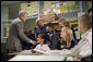 "President George W. Bush and Education Secretary Margaret Spellings visit with students at North Glen Elementary School in Glen Burnie, Md., Monday, Jan. 9, 2006. ""This is a fine school,"" said the President in his remarks about 'No Child Left Behind' at the school. ""We're here to herald excellence. We're here to praise the law that is working. I'm here to thank the teachers, not only here, but around the state of Maryland and around the country, who are dedicating their lives to providing hope for our future."" White House photo by Kimberlee Hewitt"