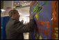 President George W. Bush signs a classroom door during his visit with teachers and students at North Glen Elementary School in Glen Burnie, Md., Monday, Jan. 9, 2006. White House photo by Kimberlee Hewitt