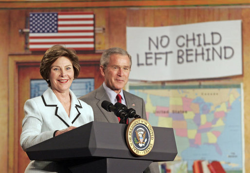 "Laura Bush and President Bush discuss ""No Child Left Behind,"" at North Glen Elementary School in Glen Burnie, Md., Monday, Jan. 9, 2006. ""Interestingly enough, in 2003, 45 percent of the African American students in this school rated proficient in reading; in 2005, 84 percent are proficient. In other words, this is a school that believes every child can learn. Not just certain children, every child,"" said the President. White House photo by Kimberlee Hewitt"