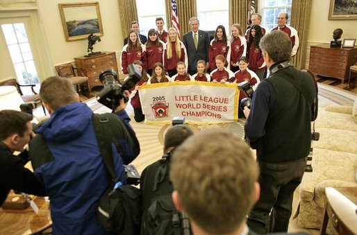 President George W. Bush stands with the 2005 Little League Softball World Series Champions in the Oval Office Tuesday, Jan. 10, 2006. The McLean, Va., All-Star team represented the South Region and bested six regional championship teams during a week-long tournament in Portland, Ore. White House photo by Eric Draper
