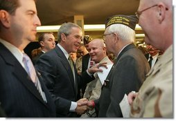 "After talking about progress in the War on Terror with members of the Veterans of Foreign War, President George W. Bush greets audience members in Washington, D.C., Jan. 10, 2006. ""This is one of America's great organizations. I appreciate the proud and patriotic work you do across America,"" said the President.  White House photo by Paul Morse"