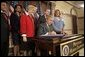 President George W. Bush signs H.R. 972, the Trafficking Victims Protection Reauthorization Act of 2005, in the Dwight D. Eisenhower Executive Office Building Tuesday, Jan. 10, 2006. The bill directs the U.S. Agency for International Development (USAID), the State Dept., and Dept. of Defense to incorporate anti-trafficking and protection measures for vulnerable populations, particularly women and children, into their post-conflict and humanitarian emergency assistance and program activities. White House photo by Eric Draper