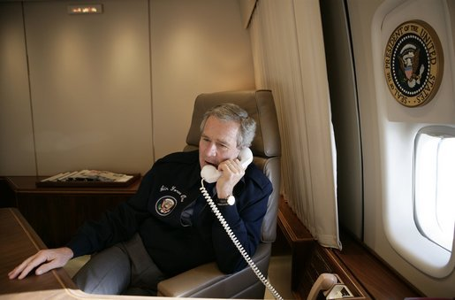 Calling from Air Force One, President George W. Bush talks with Supreme Court Associate Justice nominee Judge Samuel Alito Thursday, Jan. 12, 2006, on the final day of the judge's confirmation hearings before the Senate Judiciary Committee. White House photo by Eric Draper