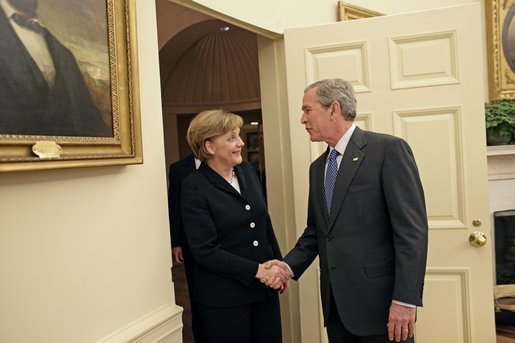 President George W. Bush welcomes German Chancellor Angela Merkel to the Oval Office Friday, Jan. 13, 2006. It is Chancellor Merkel's first visit to the White House. White House photo by Eric Draper