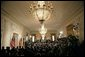 The East Room of the White House is filled as President George W. Bush and German Chancellor Angela Merkel deliver remarks during a joint press availability Friday, Jan. 13, 2006. White House photo by Eric Draper