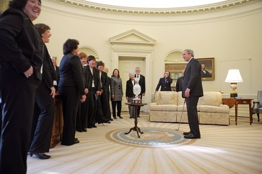 President George W. Bush hosts a visit to the Oval Office by the 2005 U.S. Solheim Cup Team Friday, Jan. 13, 2006. The Solheim Cup is a biennial competition between the top United States and Europe's women golfers. White House photo by Paul Morse