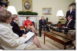 President George W. Bush meets with business leaders to discuss Central American Relief and Reconstruction Efforts in the Oval Office Friday, Jan. 13, 2006. From left, they are: Robert Lane of Deer & Co., Maria Elena Lagomasino of Asset Management Advisors, LLC., and Steve Reinmund of PepsiCo. Under Secretary of State Karen Hughes is pictured at the far left.  White House photo by Paul Morse