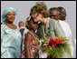 Mrs. Laura Bush embraces 10-year-old Aisha Garuba Sunday, Jan. 15, 2006, after she presented Mrs. Bush with flowers upon her arrival at Kotoka International Airport in Accra, Ghana. White House photo by Shealah Craighead