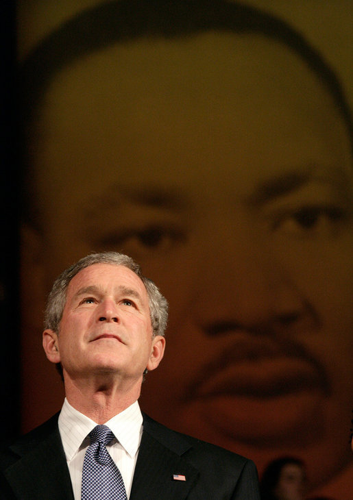 "President George W. Bush looks up at the audience while taking the stage before his remarks at Georgetown University's ""Let Freedom Ring"" Celebration Honoring Dr. Martin Luther King at the John F. Kennedy Center for the Performing Arts, Monday, Jan. 16, 2006. White House photo by Eric Draper"