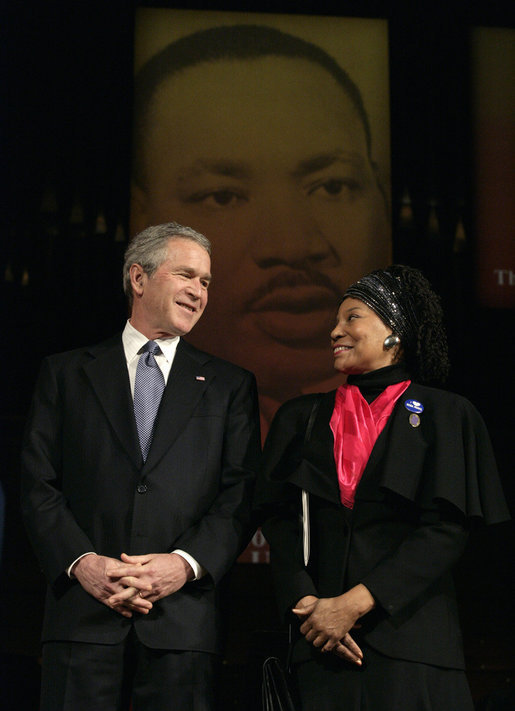 "President George W. Bush is joined on stage by Elaine Steele during Georgetown University's ""Let Freedom Ring"" Celebration Honoring Dr. Martin Luther King at the John F. Kennedy Center, Monday, Jan. 16, 2006. Steele, Co-Founder of Rosa and Raymond Parks Institute, was presented with the ""John Thompson Legacy of a Dream Award"". White House photo by Eric Draper"
