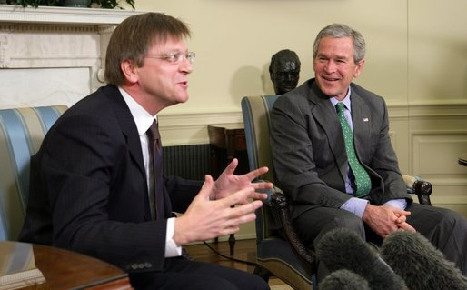President George W. Bush breaks out in laughter as he listens to Belgian Prime Minister Guy Verhofstadt Tuesday, January 17, 2006, during the Prime Minister's visit to the Oval Office. White House photo by Paul Morse