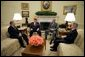 President George W. Bush meets with Tom Bock, the national commander of the American Legion, in the Oval Office Tuesday, Jan. 17, 2006. Also pictured, from left, are: John Sommer, executive director of the American Legion's Washington office, and Jim Nicholson, Secretary of Veterans Affairs. White House photo by Paul Morse