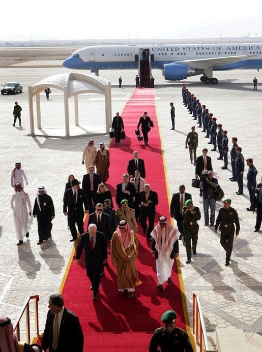 Followed by a group of Saudi and US delegates, Vice President Dick Cheney walks down a red carpet with Prince Saud al-Faisal bin Abdulaziz, Saudi Minister of Foreign Affairs, upon arrival to King Khalid International Airport in Saudi Arabia, Tuesday January 17, 2006. White House photo by David Bohrer