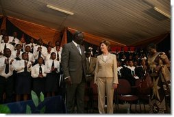 Mrs. Laura Bush and Ghana President John Agyekum Kufuor appear together at the launch of the Africa Education Initiative Textbooks Program Tuesday, Jan. 17, 2006 in Accra, Ghana. White House photo by Shealah Craighead