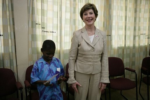Mrs. Laura Bush stands with a young boy as she visits with patients, their family members and staff at the Korle-Bu Treatment Center, Tuesday, Jan. 17, 2006 in Accra, Ghana. White House photo by Shealah Craighead