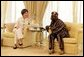 Mrs. Laura Bush visits with Nigeria President Olusegun Obasanjo Wednesday, Jan. 18, 2006, at the presidential villa in Abuja, Nigeria. White House photo by Shealah Craighead