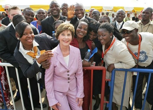 Laura Bush poses with U.S. Embassy workers and their family members, Wednesday, Jan. 18, 2006, during a stop at the U.S. Embassy in Abuja, Nigeria. White House photo by Shealah Craighead
