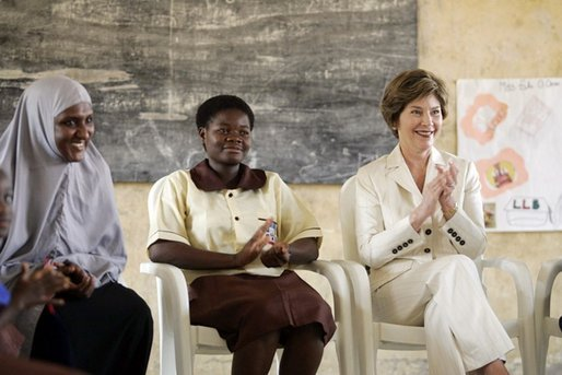 Laura Bush applauds during her visit Wednesday, Jan. 18, 2006, to Model Secondary School in Abuja, Nigeria. White House photo by Shealah Craighead