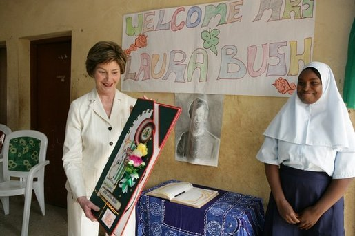 Laura Bush admires a gift presented to her at the conclusion of her visit to the Model Secondary School in Abuja, Nigeria, January 18, 2006. White House photo by Shealah Craighead
