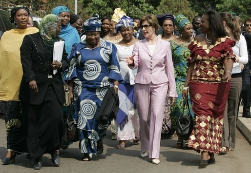 Laura Bush walks with members of the National Center for Women's Development in Abuja, Nigeria to the Women's Hall of Fame January 18, 2006. White House photo by Shealah Craighead