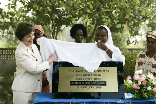 Mrs. Laura Bush helps unveil a plaque dedicating the Saint Kizito Complex at Saint-Mary's Catholic Church in Gwagwalada, Nigeria Wednesday, Jan. 18, 2006. White House photo by Shealah Craighead