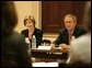 President George W. Bush and Mrs. Bush listen during meeting with heads of foundations to help aid Gulf Coast Recovery at the White House, Thursday, Jan. 19, 2006. White House photo by Eric Draper