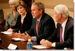 President George W. Bush, with Mrs. Bush, speaks to the press during a meeting with foundations to help aid Gulf coast Recovery at the White House, Thursday, Jan. 19, 2006.  White House photo by Eric Draper