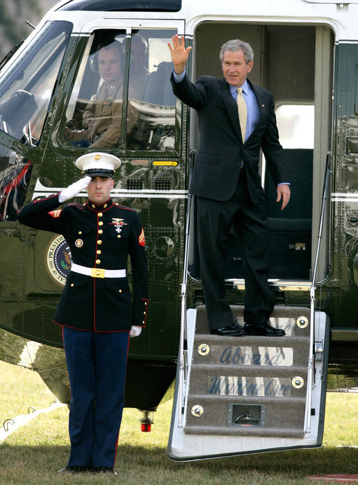 President George W. Bush waves to guests on the South Lawn before departing for Camp David aboard Marine One, Friday, Jan. 20, 2006. White House photo by Eric Draper