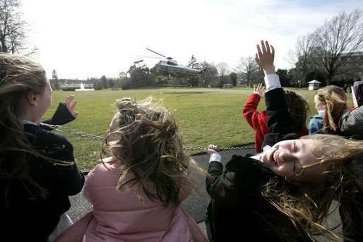 Students from Loudoun Country Day School react as they view the departure of Marine One with President George W. Bush aboard on the South Lawn, Friday, Jan. 20, 2006. White House photo by Eric Draper