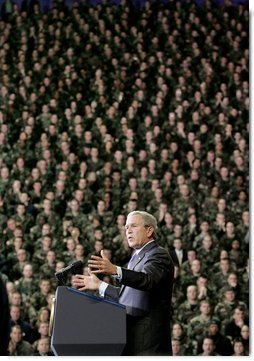 President George W. Bush delivers remarks on the global war on terror at Kansas State University in Manhattan, Kan., Monday, Jan. 23, 2006. Pictured behind the President are 1,000 military personnel from Fort Riley, Kan.  White House photo by Eric Draper
